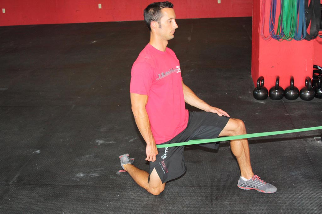 banded hip capsule extension